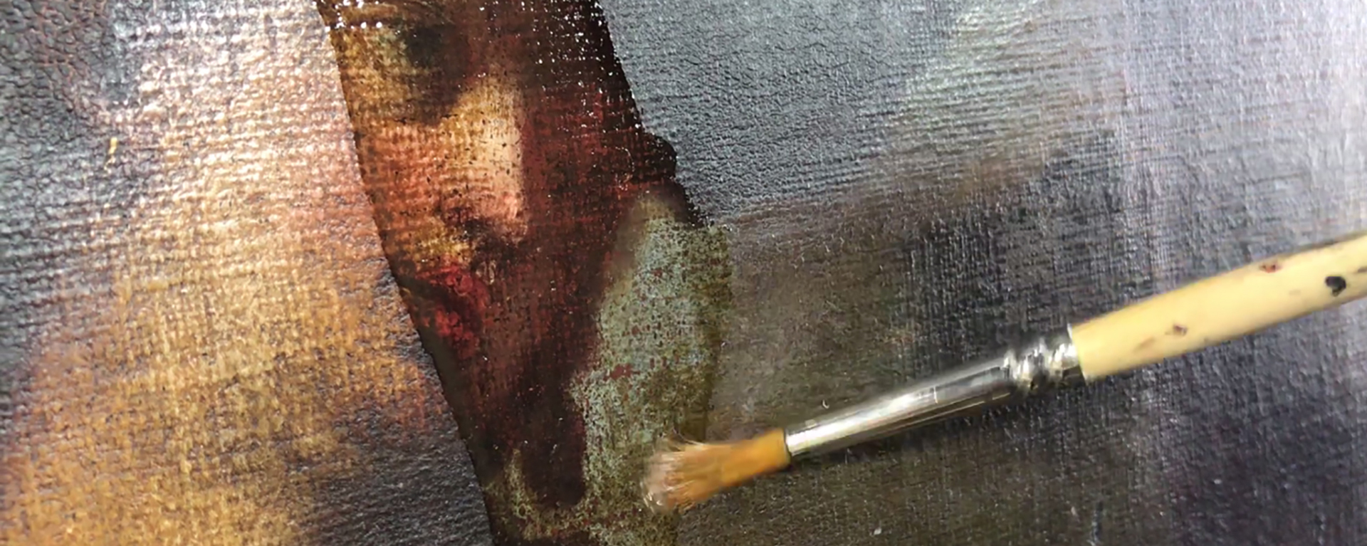 closeup photo of a paint brush cleaning a painting